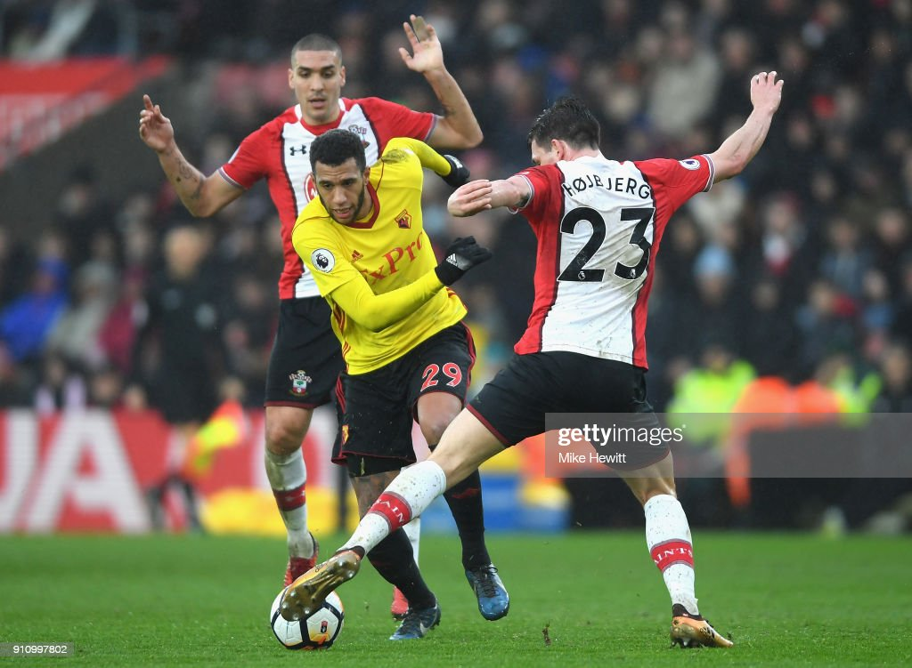 Etienne Capoue of Watford is challenged by Pierre-Emile Hojbjerg of Southampton during The Emirates FA Cup Fourth Round match between Southampton and Watford at St Mary's Stadium on January 27, 2018 in Southampton, England.