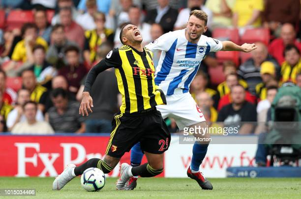 Etienne Capoue of Watford is fouled by Dale Stephens of Brighton and Hove Albion during the Premier League match between Watford FC and Brighton Hove...