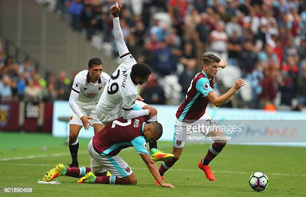 Etienne Capoue of Watford is fouled by Winston Reid of West Ham United during the Premier League match between West Ham United and Watford at Olympic...