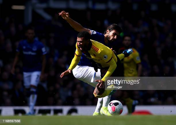 Etienne Capoue of Watford is tackled Andre Gomes of Everton during the Premier League match between Everton FC and Watford FC at Goodison Park on...