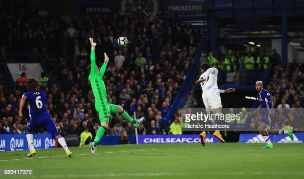 Etienne Capoue of Watford scores his sides first goal past Asmir Begovic of Chelsea during the Premier League match between Chelsea and Watford at...