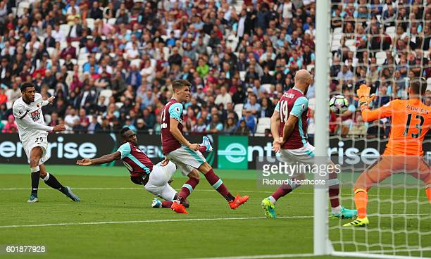 Etienne Capoue of Watford scores his sides third goal during the Premier League match between West Ham United and Watford at Olympic Stadium on...