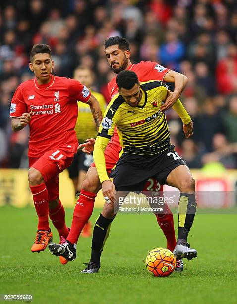 Etienne Capoue of Watford shields the ball from Emre Can of Liverpool during the Barclays Premier League match between Watford and Liverpool at...