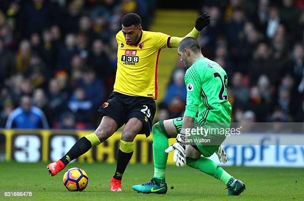 Etienne Capoue of Watford shoots while Victor Valdes of Middlesbrough saves during the Premier League match between Watford and Middlesbrough at...