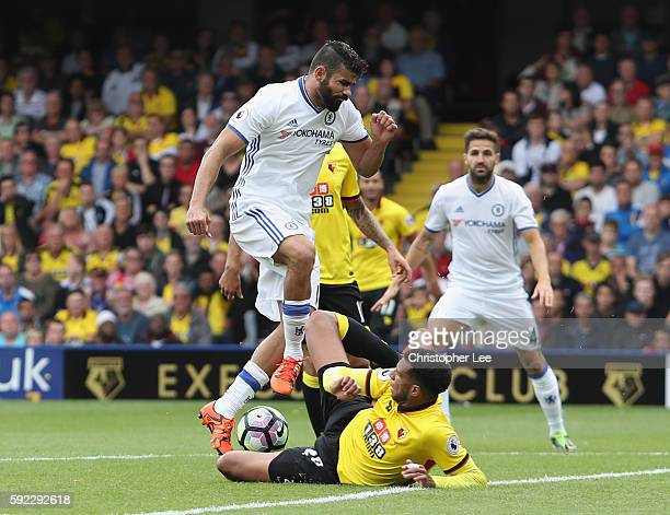 Etienne Capoue of Watford slides in to stop Diego Costa of Chelsea which lead the Capoue leaving the field with an injury during the Premier League...