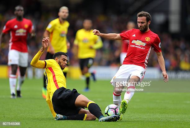 Etienne Capoue of Watford tackles Juan Mata of Manchester United during the Premier League match between Watford and Manchester United at Vicarage...
