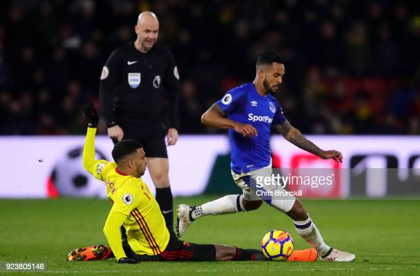 Etienne Capoue of Watford tackles Theo Walcott of Everton during the Premier League match between Watford and Everton at Vicarage Road on February 24...
