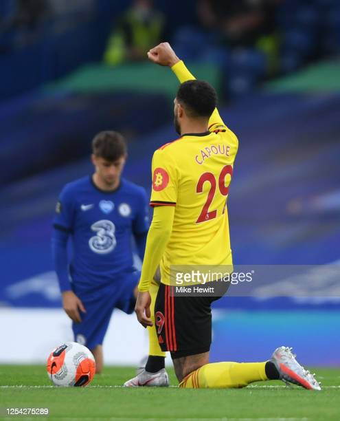 Etienne Capoue of Watford takes a knee in support of the Black Lives Matter movement prior to the Premier League match between Chelsea FC and Watford...