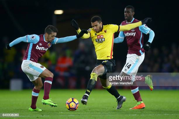 Etienne Capoue of Watford takes on Manuel Lanzini of West Ham United during the Premier League match between Watford and West Ham United at Vicarage...