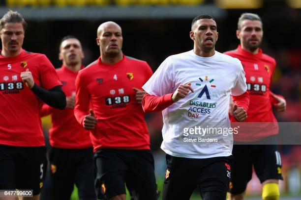 Etienne Capoue of Watford warms up wearing his 'Disabled acess day' tshirt prior to the Premier League match between Watford and Southampton at...