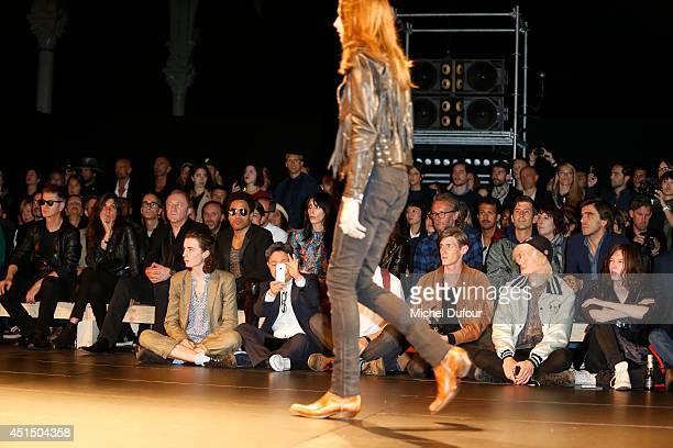 Etienne Daho Emmanuelle Alt Francois Henri Pinault Lenny Kravitz and Jamie Bochert attend the Saint Laurent show as part of the Paris Fashion Week...