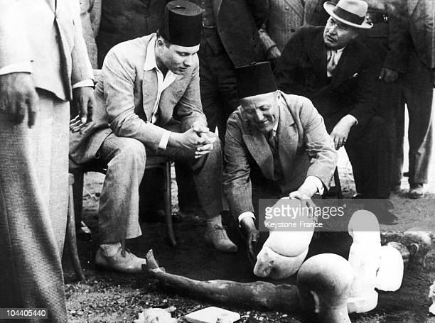 Etienne DRIOTON the director of the department of Egyptian Antiquities in Egypt and King FAROUK 1st of Egypt studying statues representing the heads...