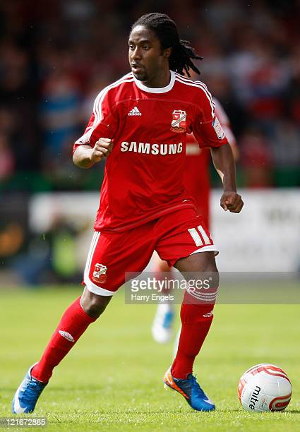 Etienne Esajas of Swindon Town in action during the npower League Two match between Swindon Town FC and Oxford United at the County Ground on August...