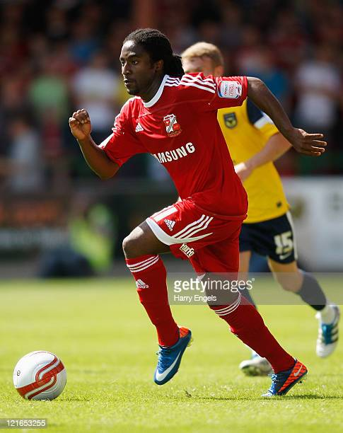 Etienne Esajas of Swindon Town runs with the ball during the npower League Two match between Swindon Town FC and Oxford United at the County Ground...