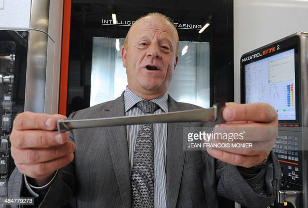 Etienne Galan French purchasing manager of SNECMA shows a TiAi turbine blade for the new jet engine LEAP of SNECMA on April 14 2014 at the Mecachrome...