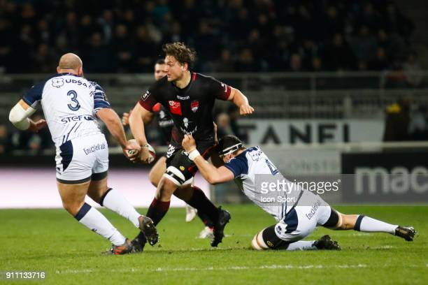 Etienne Oosthuizen of Lyon and Denis marchois of Agen and Arthur Joly of Agen during the Top 14 match between Lyon and Agen at Gerland Stadium on...