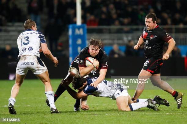 Etienne Oosthuizen of Lyon and Facundo Bosch of Agen and Johann Sadie of Agen and Mickael Ivaldi of Lyon during the Top 14 match between Lyon and...