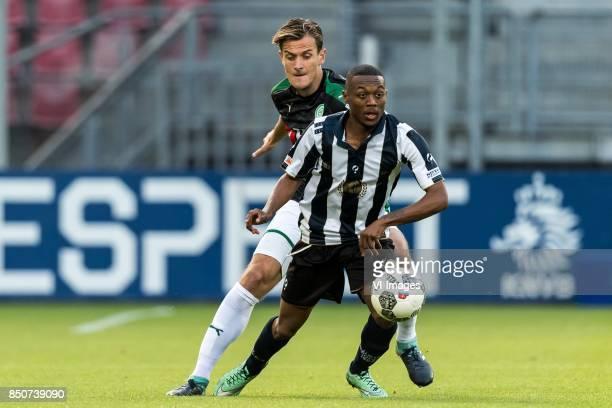 Etienne Reijnen of FC Groningen Guytho Mijland of USV Hercules during the First round Dutch Cup match between USV Hercules and FC Groningen at the...