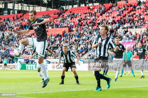 Etienne Reijnen of FC Groningen Kevin Ligtermoet of USV Hercules Floris Burgers of USV Hercules during the First round Dutch Cup match between USV...