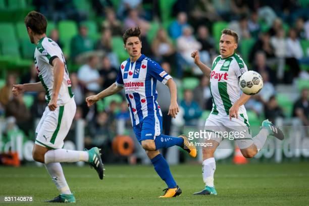 Etienne Reijnen of FC Groningen Marco Rojas of sc Heerenveen Ruben Yttergard Jenssen of FC Groningen during the Dutch Eredivisie match between FC...
