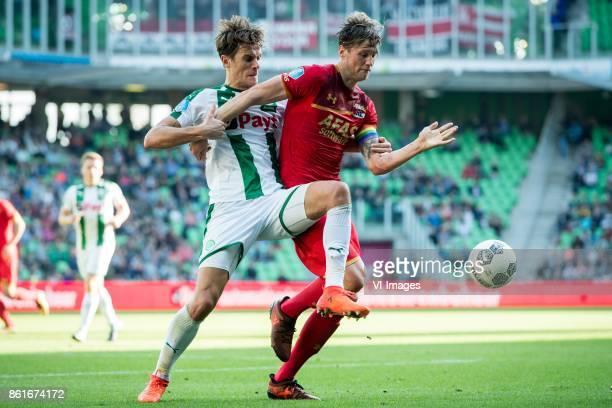 Etienne Reijnen of FC Groningen Wout Weghorst of AZ during the Dutch Eredivisie match between FC Groningen and AZ Alkmaar at Noordlease stadium on...