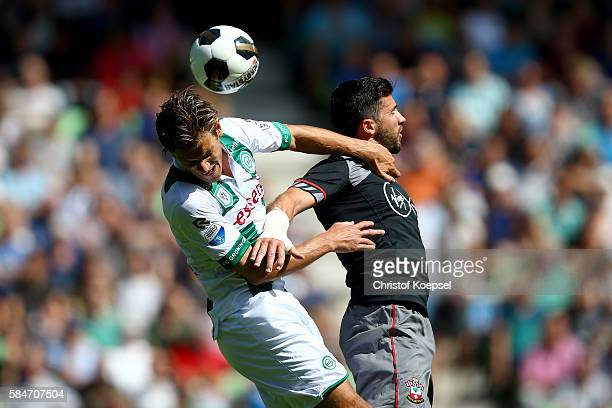 Etienne Reijnen of Groningen and Shane Long of Southampton during the friendly match between FC Groningen an FC Southampton at Euroborg Stadium on...