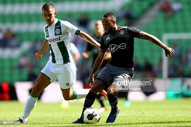 Etienne Reijnen of Groningen challenges Nathan Redmond of Southampton during the friendly match between FC Groningen an FC Southampton at Euroborg...