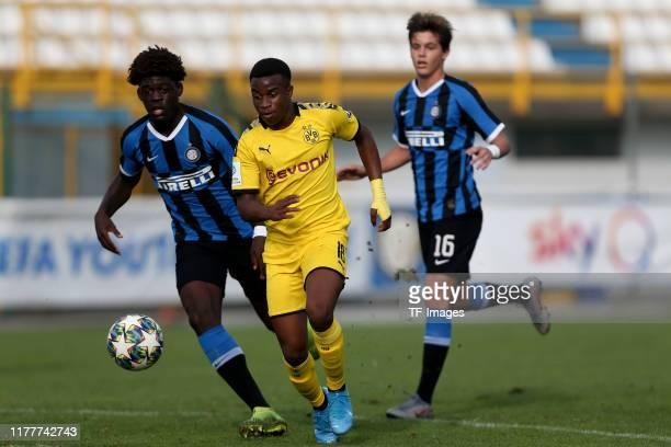 Etienne Youte Kinkoue of Inter Mailand U19 and Youssoufa Moukoko of Borussia Dortmund U19 battle for the ball during the UEFA Youth League match...