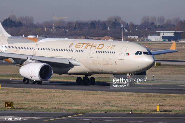 Etihad Airways Airbus A330200 airplane with registration A6EYH seen taxiing and performing take off from Dusseldorf International Airport in Germany...