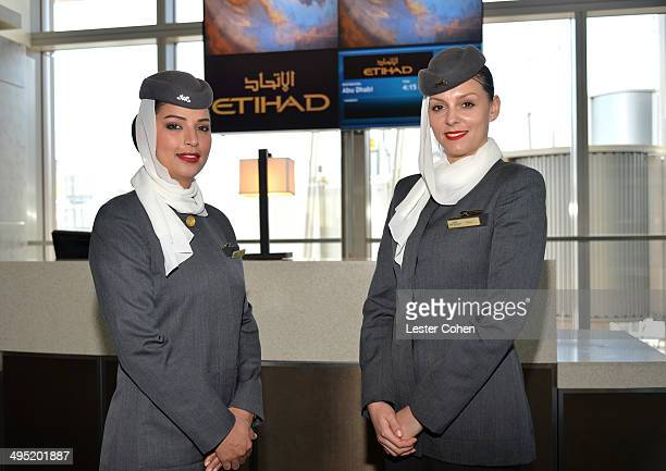 Etihad Airways' cabin crew poses at the launch of Etihad Airways' daily service from Los Angeles to Abu Dhabi at Los Angeles International Airport on...