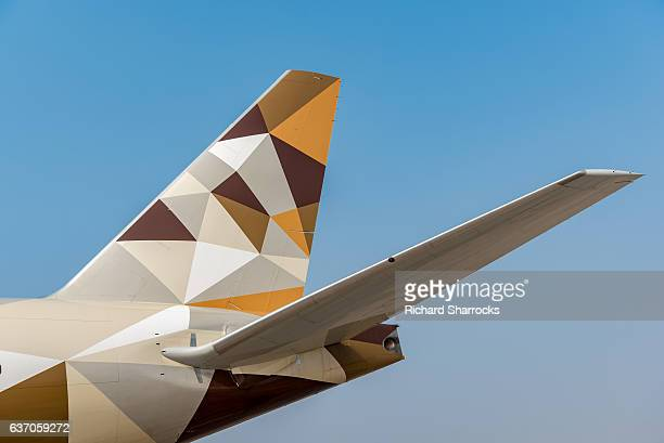 etihad boeing 777 - vertical stabilizer stock pictures, royalty-free photos & images