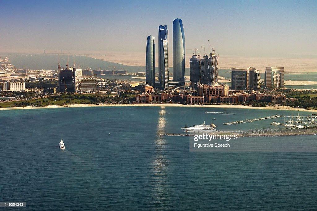 Etihad Towers and Emirates Palace : Stock Photo