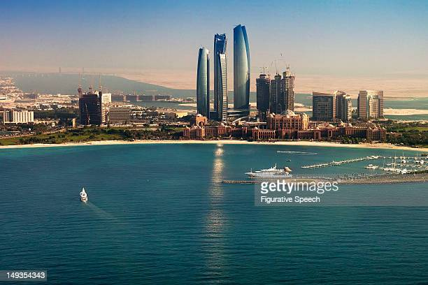 etihad towers and emirates palace - abu dhabi stock pictures, royalty-free photos & images