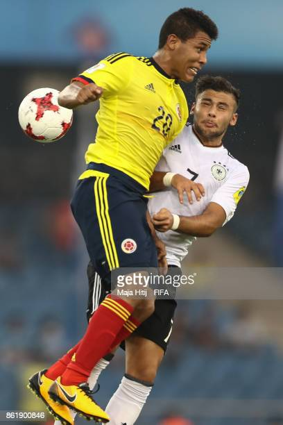 Etilso Martinez of Colombia and Sahverdi Cetin of Germany battle for the ball during the FIFA U17 World Cup India 2017 Round of 16 match between...