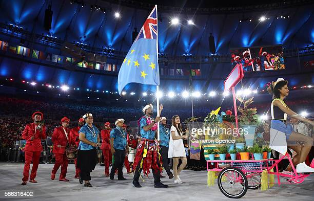 Etimoni Timuani of Tuvalu carries the flag during the Opening Ceremony of the Rio 2016 Olympic Games at Maracana Stadium on August 5 2016 in Rio de...