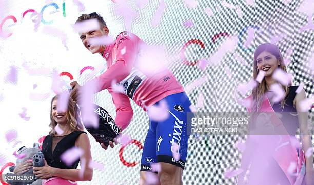 Etixx Quick Step team's German cyclist Marcel Kittel celebrates on the podium after winning the 3rd stage of the 99th Giro d'Italia Tour of Italy...
