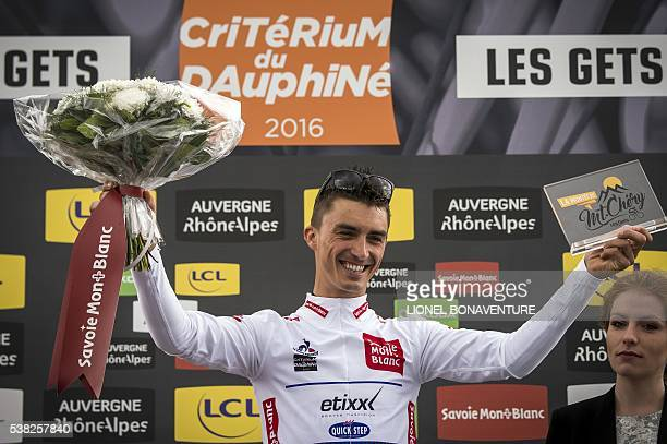 Etixx QuickStep's French rider Julian Alaphilippe celebrates on the podium with his best young white jersey during the first stage of the 68th...