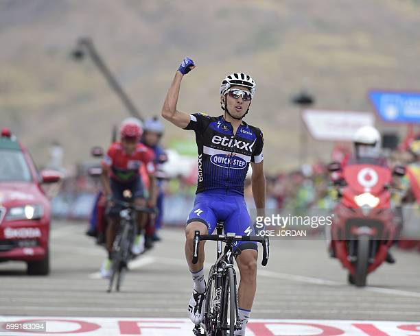 EtixxQuick Step cyclist Gianluca Brambilla celebrates winning as he crosses the finish line ahead of Movistar's Colombian cyclist Nairo Quintana...