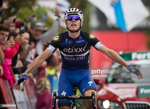 EtixxQuick Step's Spanish cyclist David de la Cruz celebrates winning as he crosses the finish line during the 9th stage of the 71st edition of La...