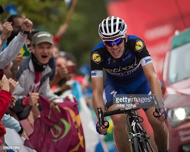 EtixxQuick Step's Spanish cyclist David de la Cruz crosses the finish line during the 9th stage of the 71st edition of La Vuelta Tour of Spain a 1645...