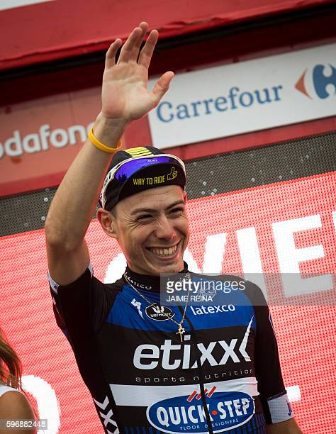 EtixxQuick Step's Spanish cyclist David de la Cruz waves as he celebrates on the podium after winning the 9th stage of the 71st edition of La Vuelta...