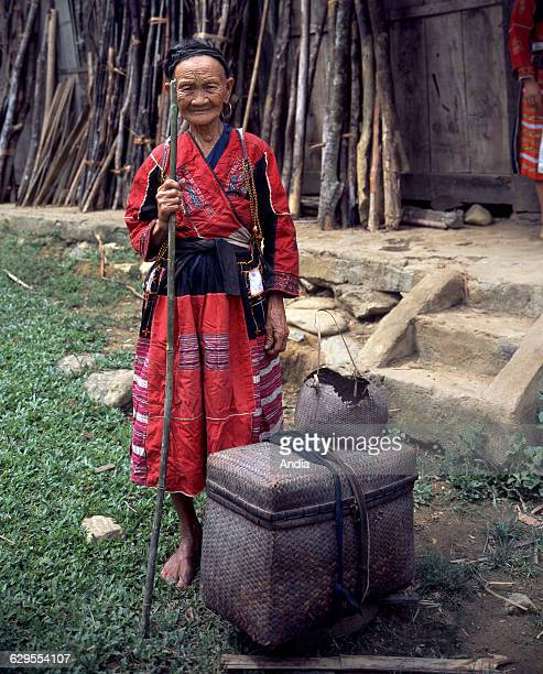Etnic groups in Vietnam , old woman belonging to the Pa Then ethnic group wearing a traditional costume. Pa Then ethnic group, South-Eastern Asia,...