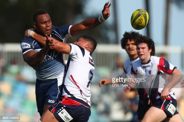 Eto Nabuli of Queensland Country offloads while takled during the round five NRC match between Queensland Country and Melbourne at Bond University on...