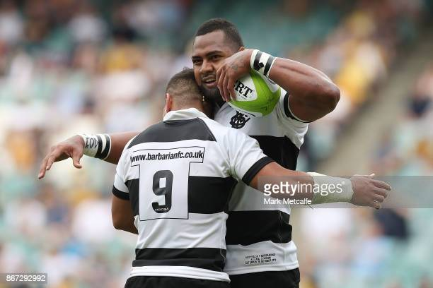 Eto Nabuli of the Barbarians celebrates scoring a try with team mate Augustine Pulu during the match between the Australian Wallabies and the...