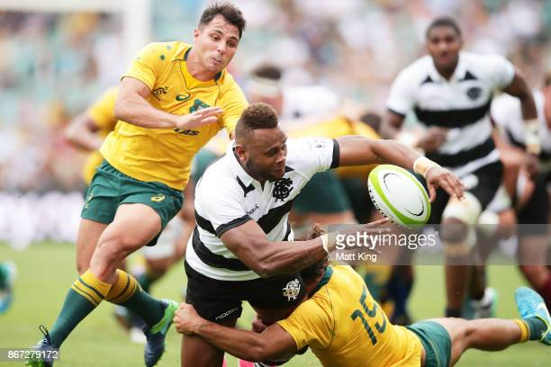 Eto Nabuli of the Barbarians offloads the ball in a tackle during the match between the Australian Wallabies and the Barbarians at Allianz Stadium on...