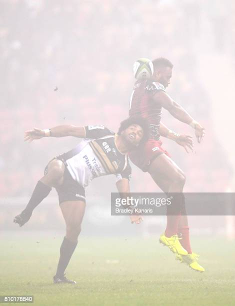 Eto Nabuli of the Reds and Henry Speight of the Brumbies challenge for the ball during the round 16 Super Rugby match between the Reds and the...