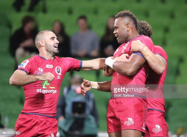 Eto Nabuli of the Reds is congratulated by Nick Frisby and Scott Higginbotham after scoring a try during the round 12 Super Rugby match between the...