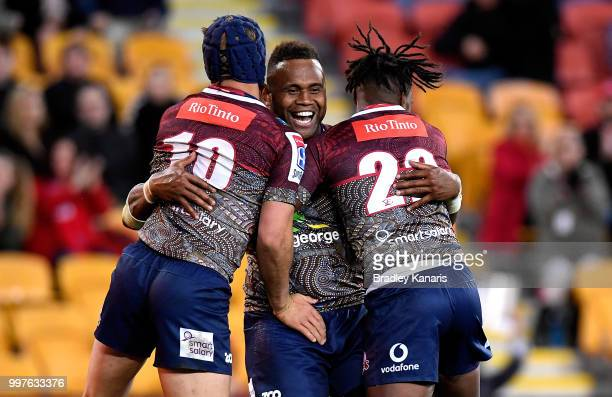 Eto Nabuli of the Reds is congratulated by team mates after scoring a try during the round 19 Super Rugby match between the Reds and the Sunwolves at...