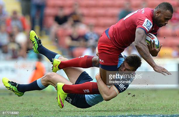 Eto Nabuli of the Reds is tackled during the round five Super Rugby match between the Reds and the Waratahs at Suncorp Stadium on March 27 2016 in...