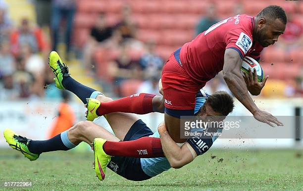 Eto Nabuli of the Reds is tackled during the round five Super Rugby match between the Reds and the Waratahs at Suncorp Stadium on March 27, 2016 in...